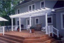 Cedar Deck with White Vinyl Shade Pergola by Archadeck