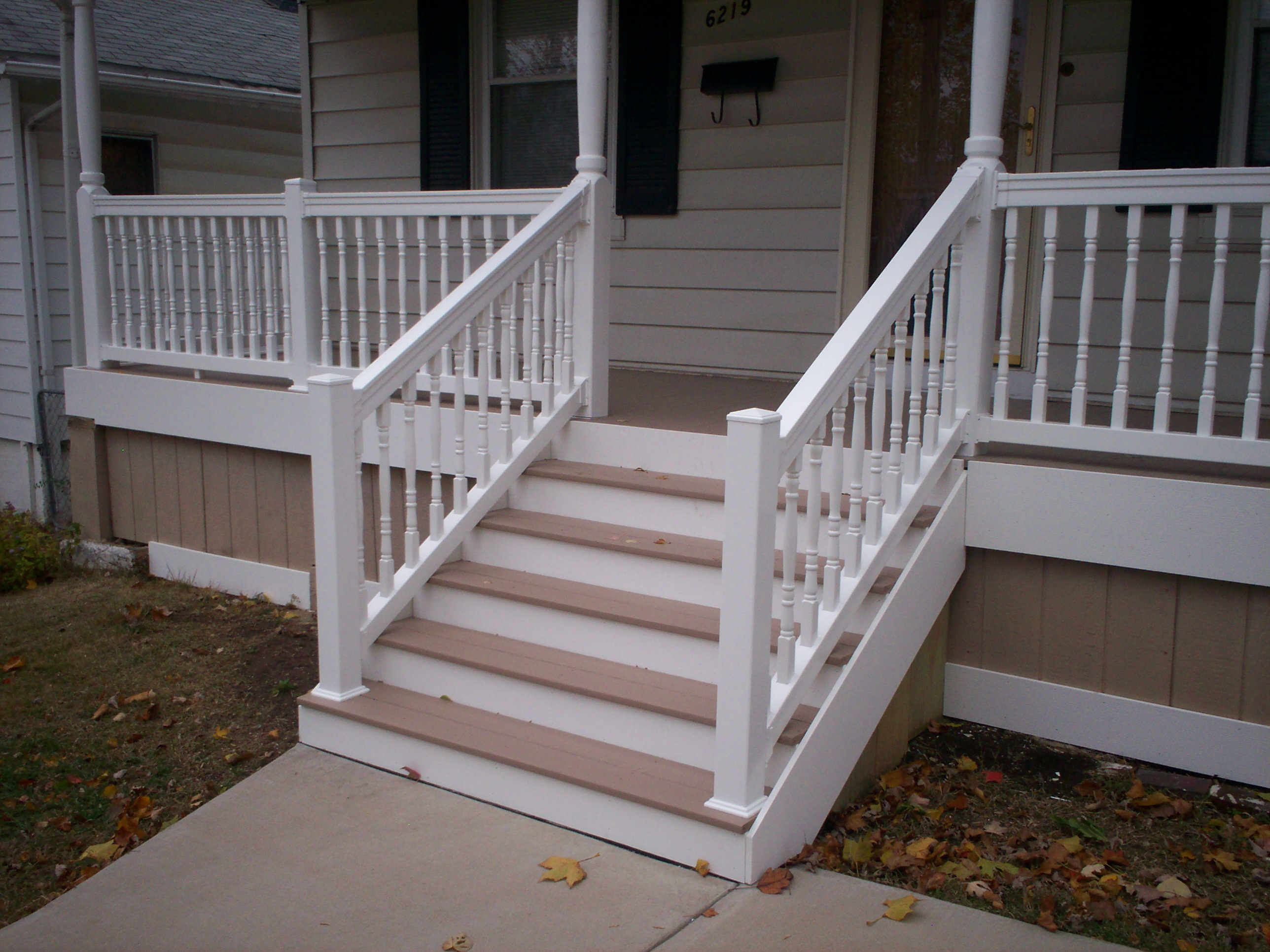 Azek front porch with vinyl railings and columns in st louis