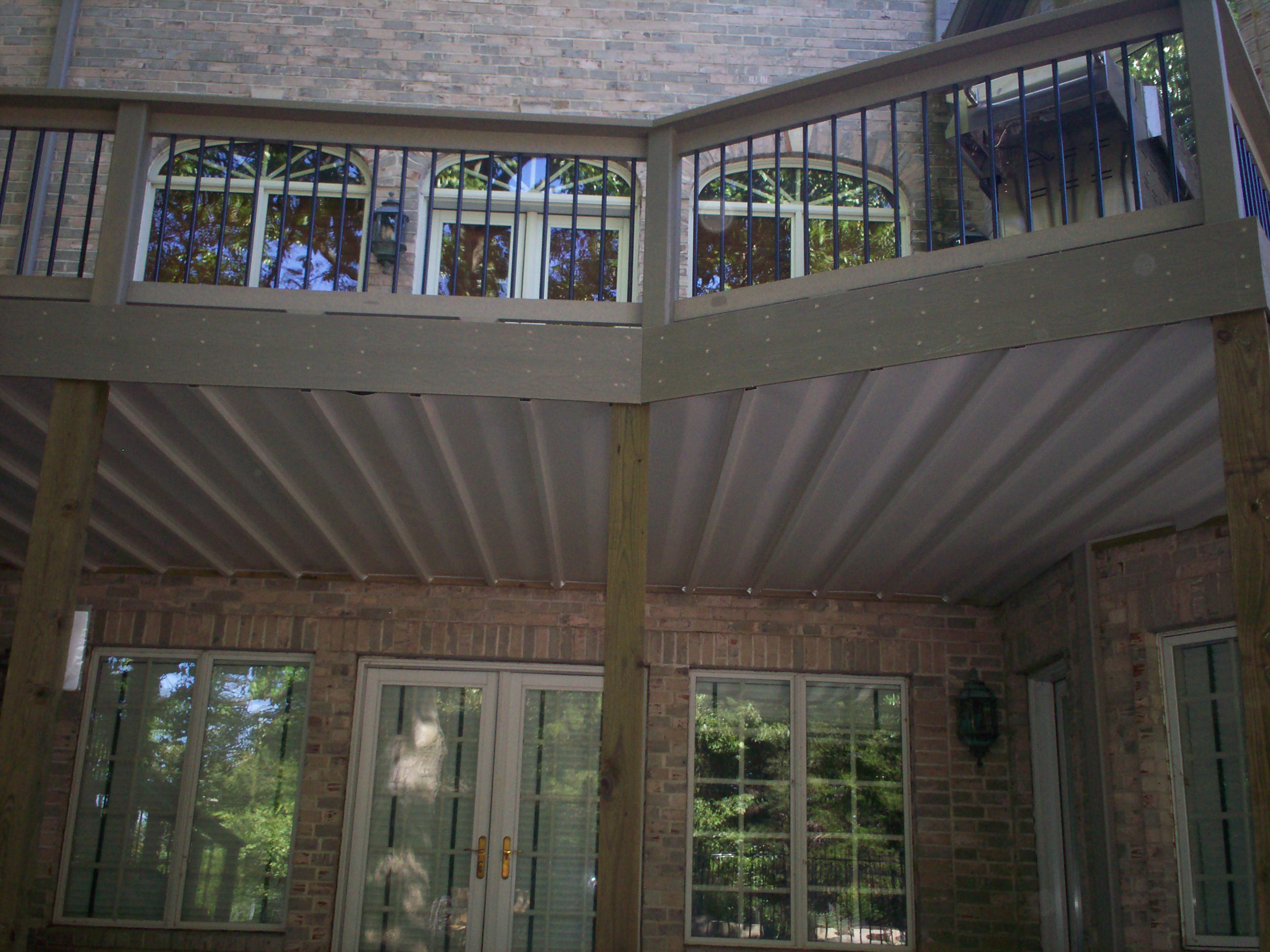 Deck drainage system st louis decks screened porches for Balcony ceiling