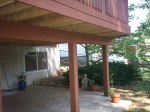 Composite Deck over Patio in St. Louis County. Beautiful example of safe and secure construction.