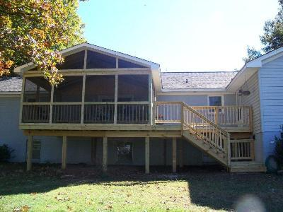 Raised screened porch with deck st louis decks for Elevated house plans with porches
