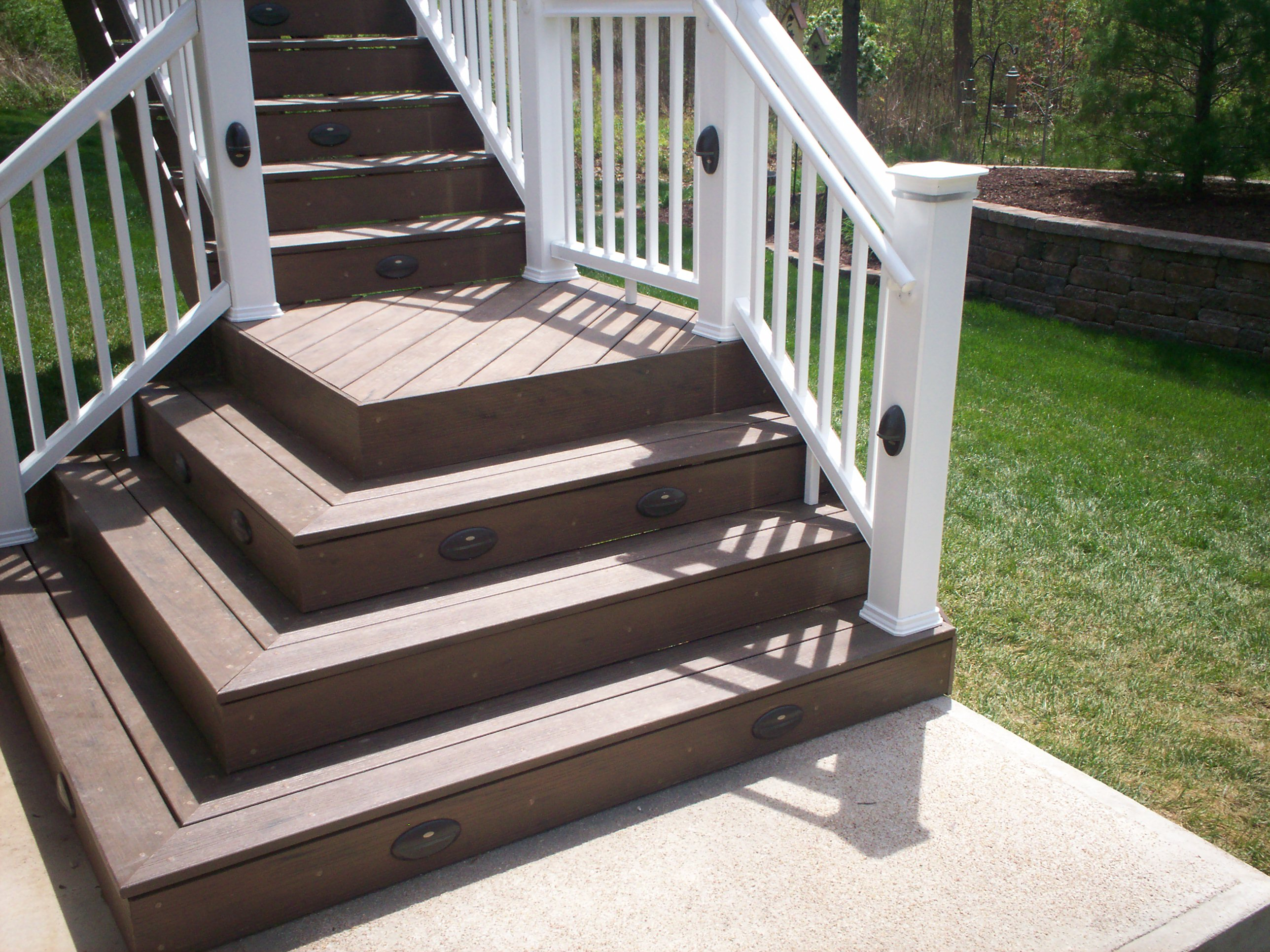 Flared deck stairs st louis decks screened porches for Steps to building a new home