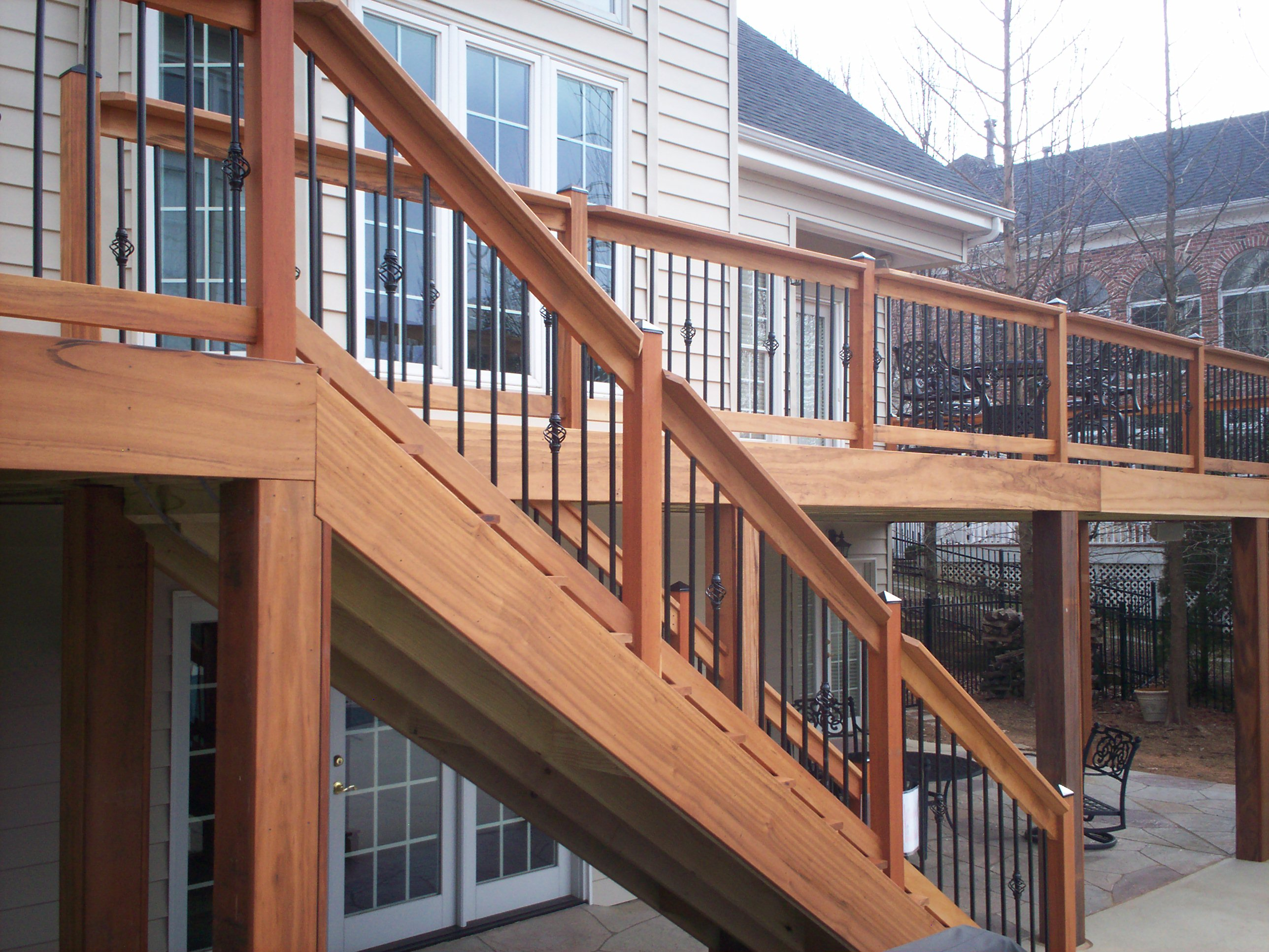 Hardwood deck railings with decorative metal balusters in for Best timber for decking