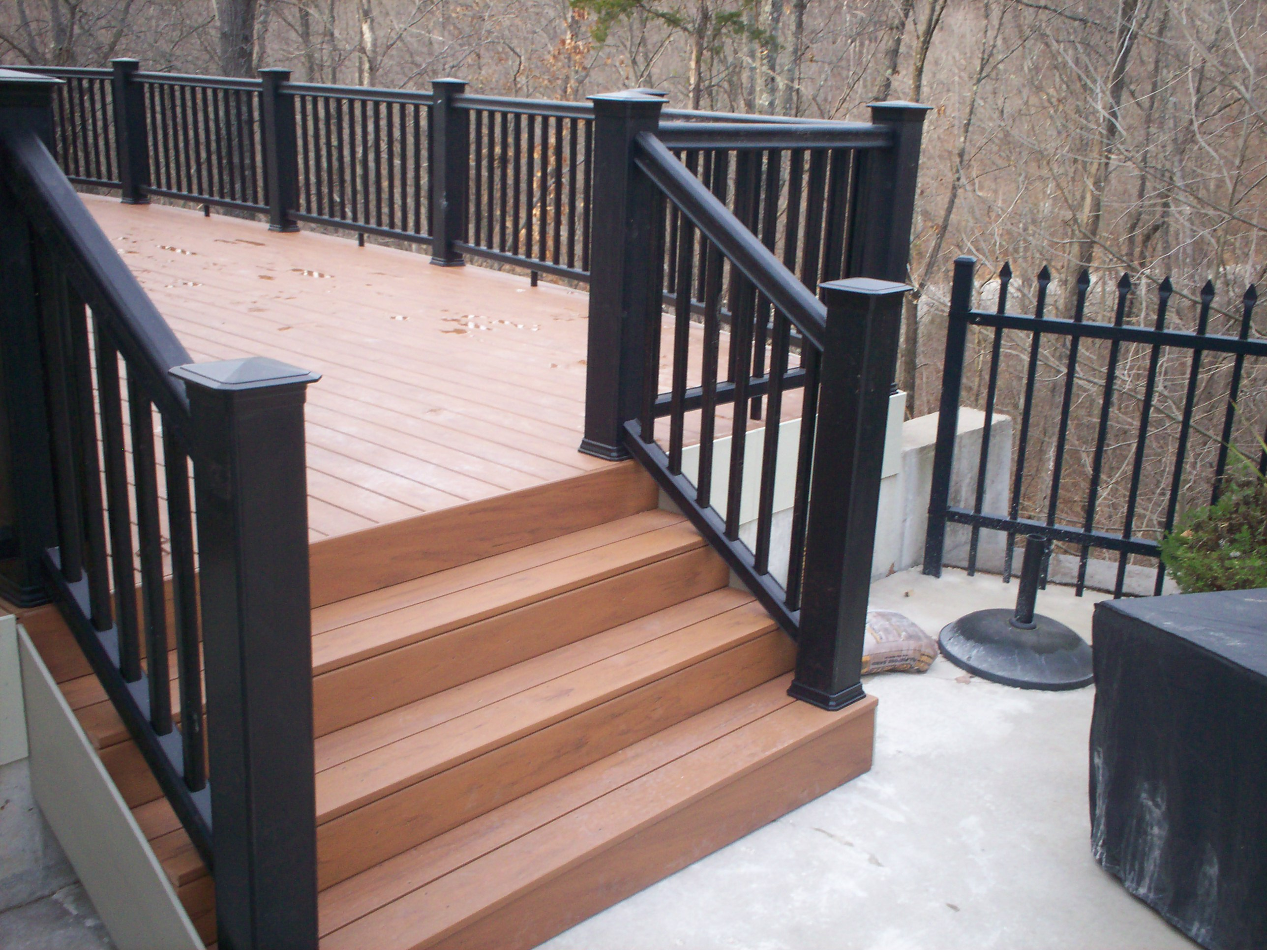 Deck benches as railing st louis decks screened for Garden decking banister