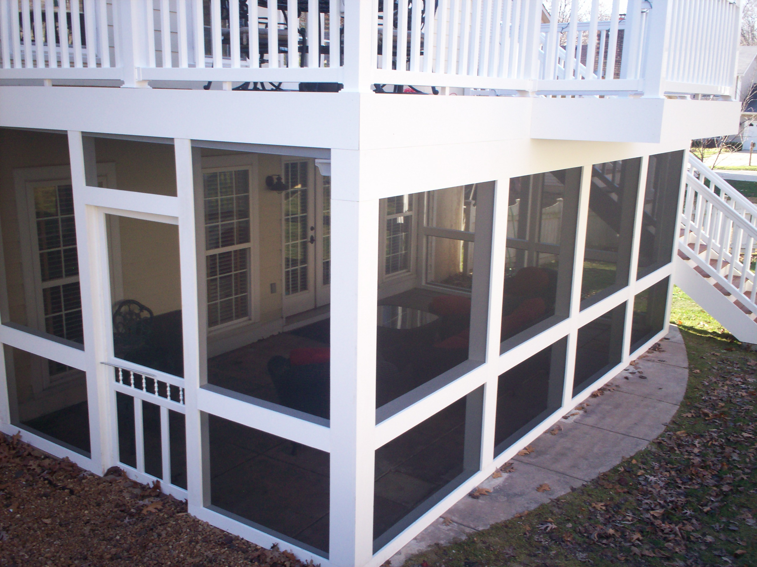 two story deck in st louis with screens and underdeck
