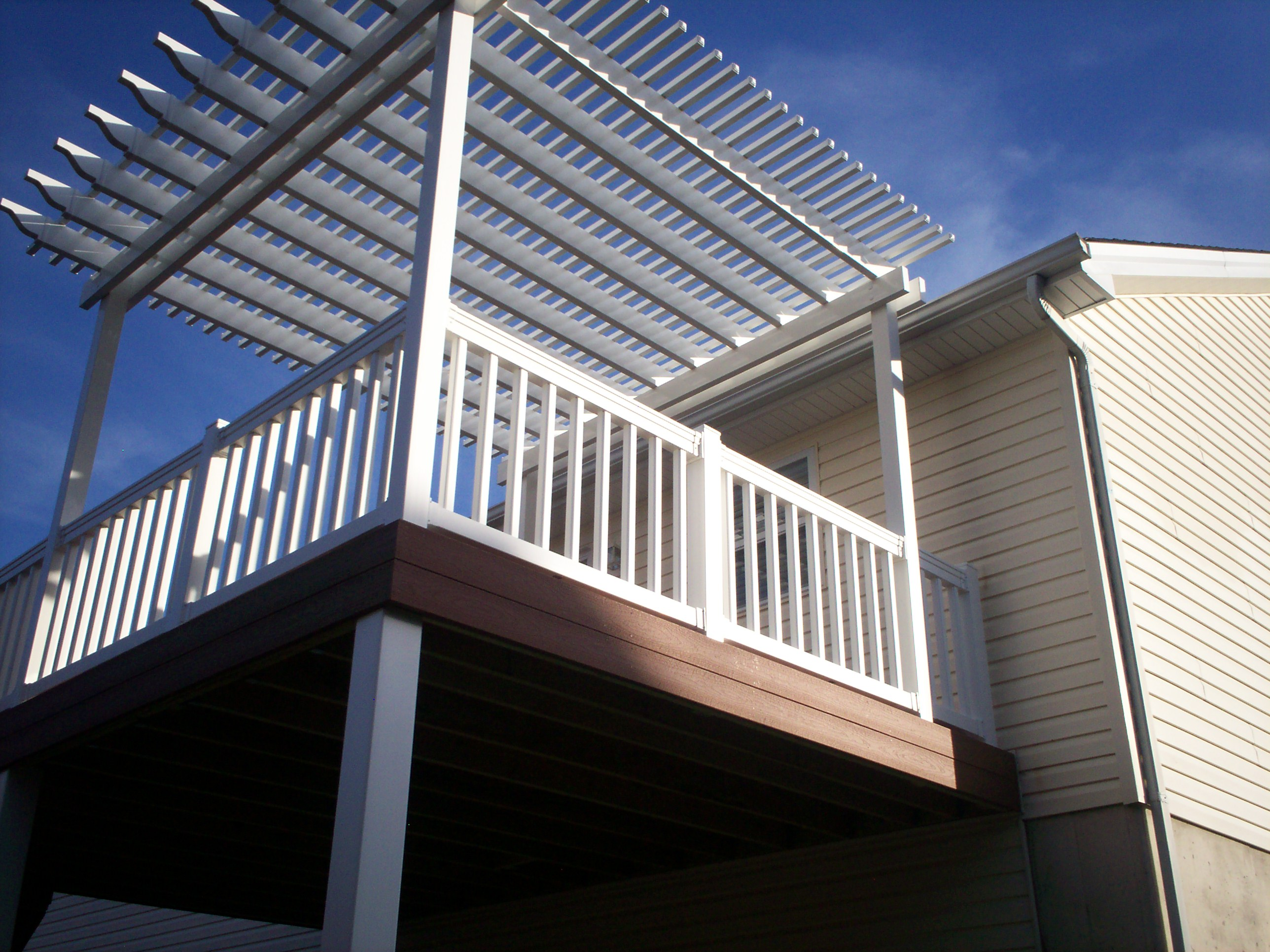 Vinyl White Pergola Over A Raised Deck In St Louis And St Charles Area