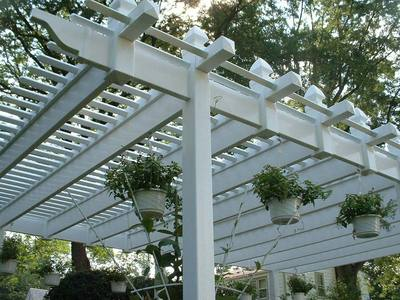 White Vinyl Pergola With Hanging Plants St Louis Decks