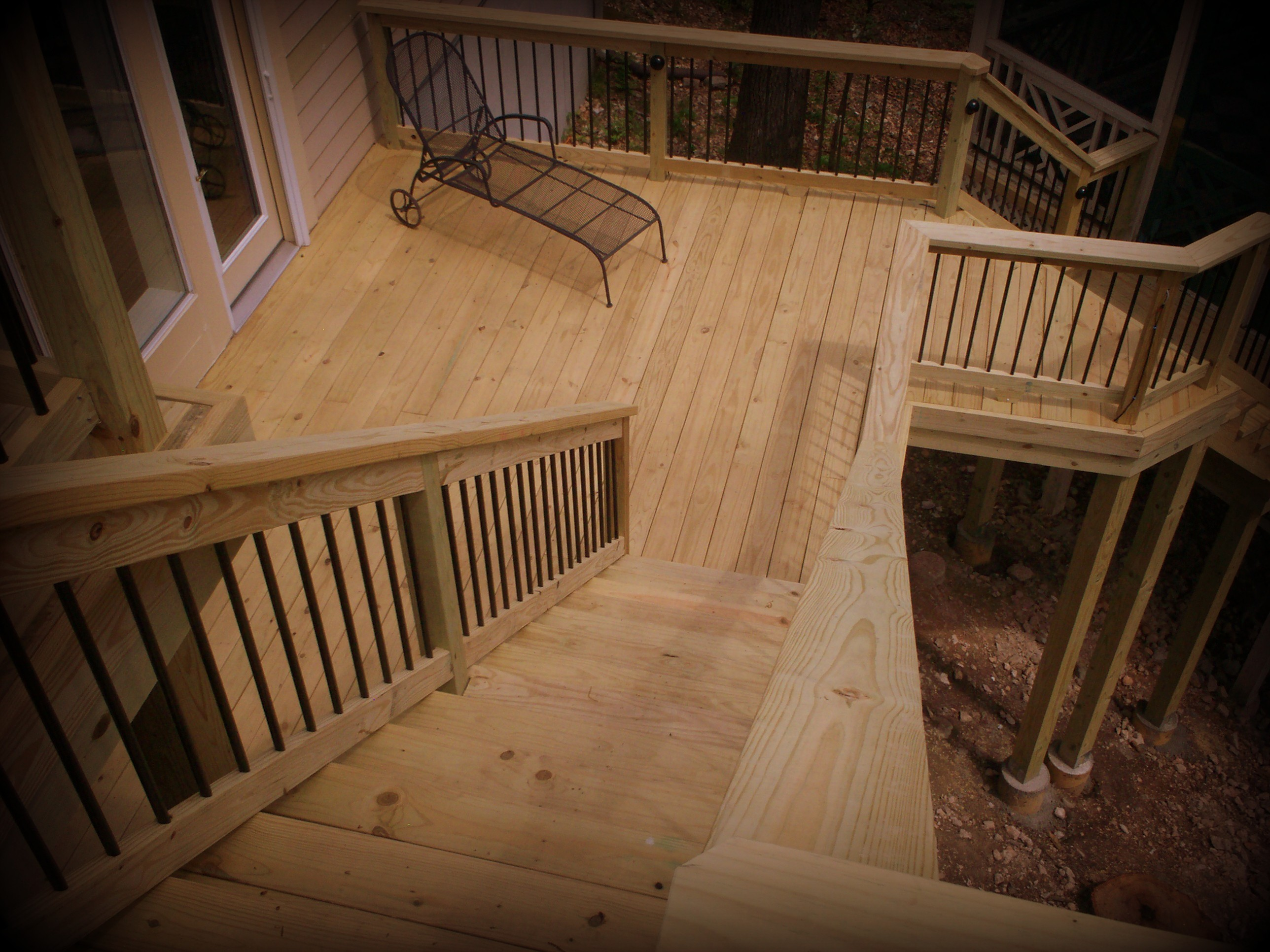 St louis deck builder the benefits of using pressure for Brown treated deck boards