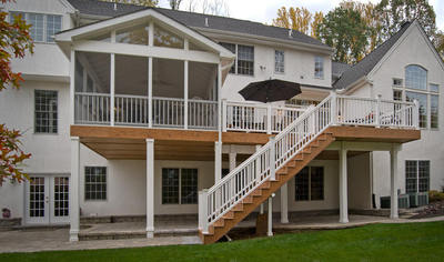 Elevated Screened In Deck With Vinyl Railings And Balusters