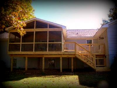 screened in deck. Wood Screened Deck For Sloping Lot With Walk-out Lower Level In