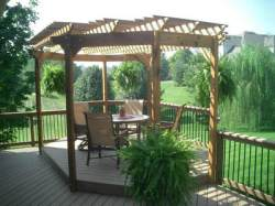 Deck and Shade Pergola by Archadeck with Hanging Plants