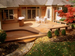 Deck by Archadeck with Curved Edges and Decorative Inlays
