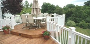 Deck with Raised Hexagon Dining Area by Archadeck