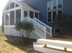 Elevated Screened Room Adjoins Grade Level Deck, Project by Archadeck