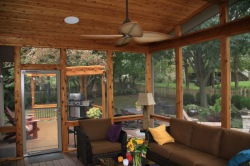 Screened in Deck with Indoor Amenities and Outdoor Cooking area