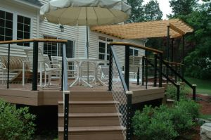 Contemporary Deck with Cable Rails by Archadeck
