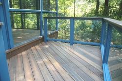 Fiberon Deck with Solid Tempered Glass Rail Panels by Archadeck
