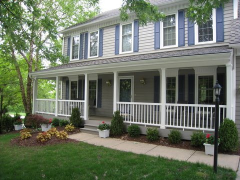 What makes a deck or porch design fit a traditional house for Colonial front porch ideas