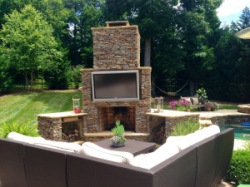 Sunbrite Outdoor Television and Fireplace by Archadeck in Charlotte
