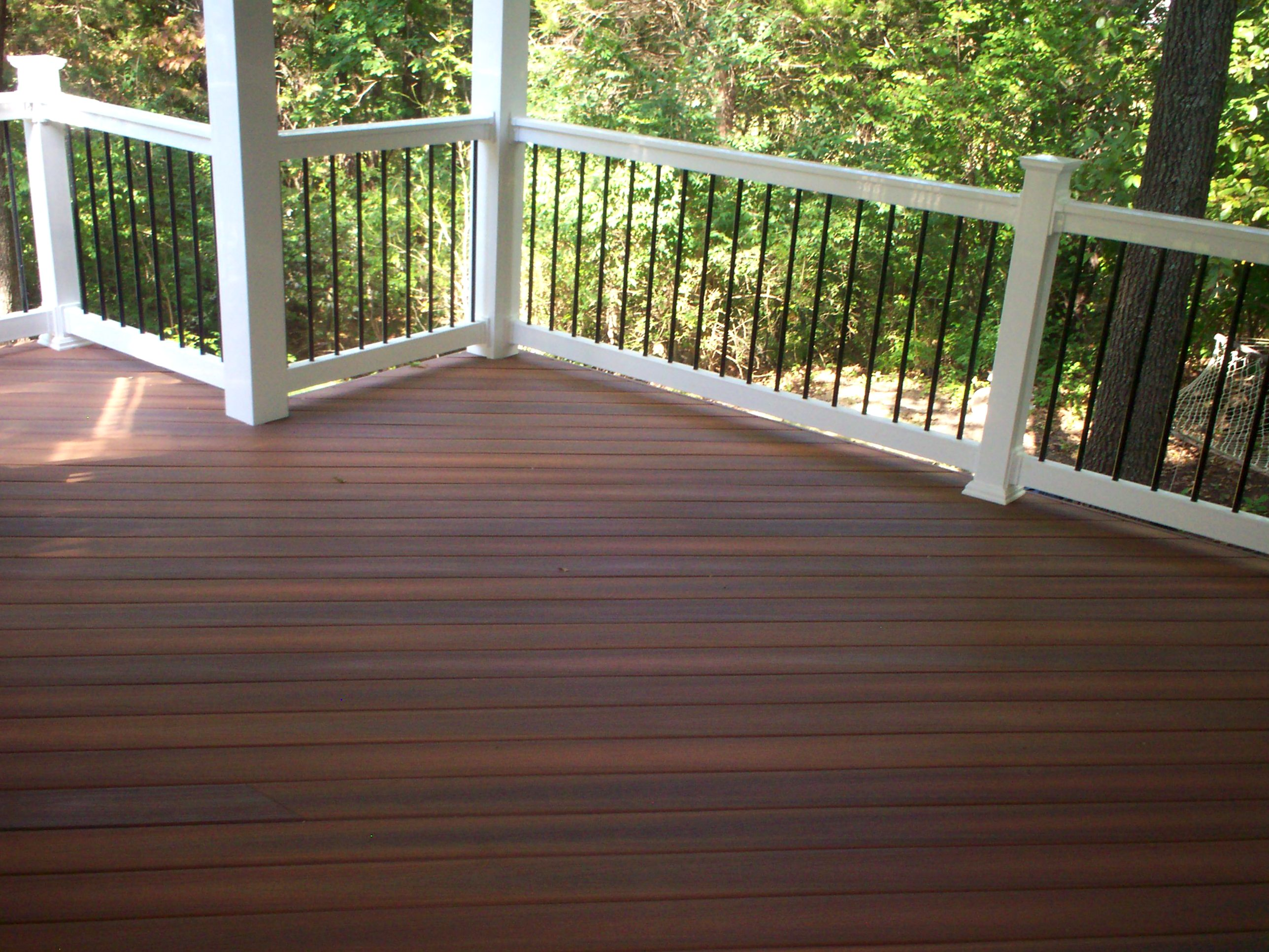 Composite vinyl decks st louis decks screened for Composite deck railing