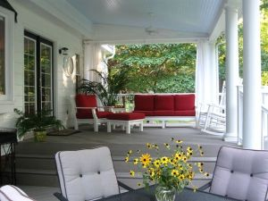 Covered Deck with Weatherproof Furnishings and Curtains, photo by Archadeck