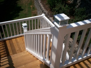 Cedar Two Story Deck with White Vinyl Rails by Archadeck in St. Louis Mo