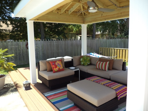 Covered Deck by Archadeck with Colorful Furnishings and Accessories