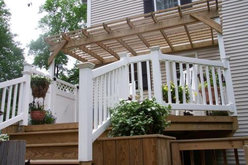 Deck with Shade Pergola, Privacy, and Planters by Archadeck
