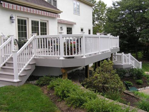 Raised Deck with Rails for Safety and Double Stairs for Backyard Access, Project by Archadeck