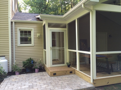 Grade-level Screened In Deck with Patio by Archadeck