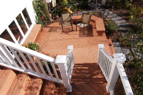 Second Story Deck Leading to First Floor Deck by Archadeck