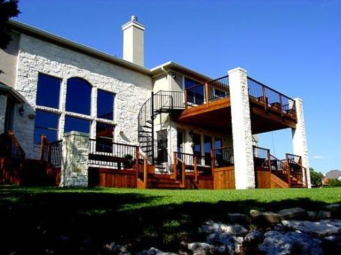 Two-Story Deck with Level Change and Spiral Stairs by Archadeck