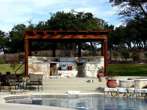 Shade Pergola for a Backyard Pool and Outdoor Kitchen by Archadeck