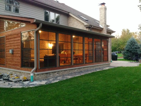 Cedar Screen Porch with 4-Track Windows Designed to Complement the Home's Exterior by Archadeck