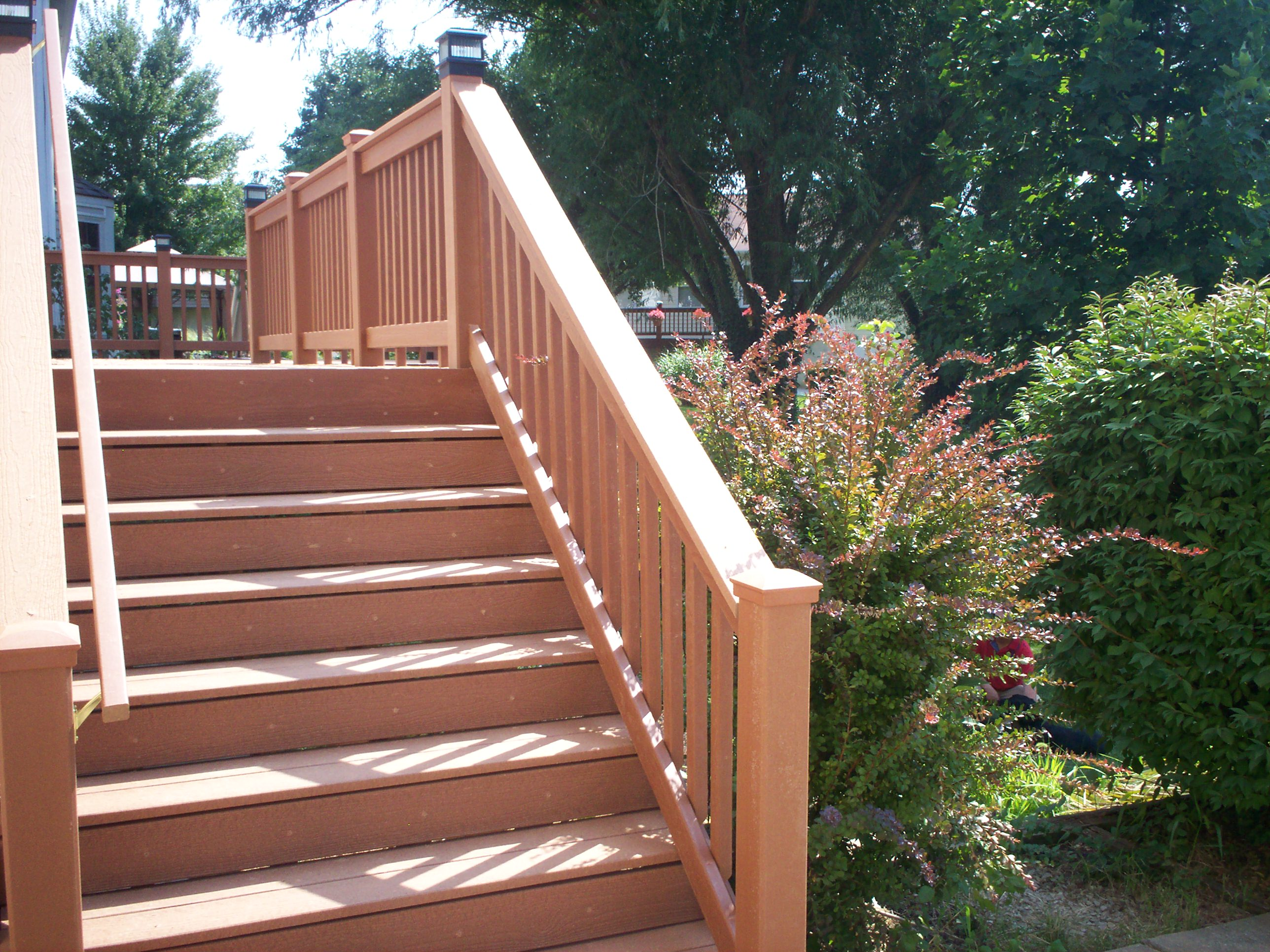 Deck stairs ideas how to choose the best stair design for your deck steps with guard rail and hand rail st louis mo by archadeck baanklon Gallery