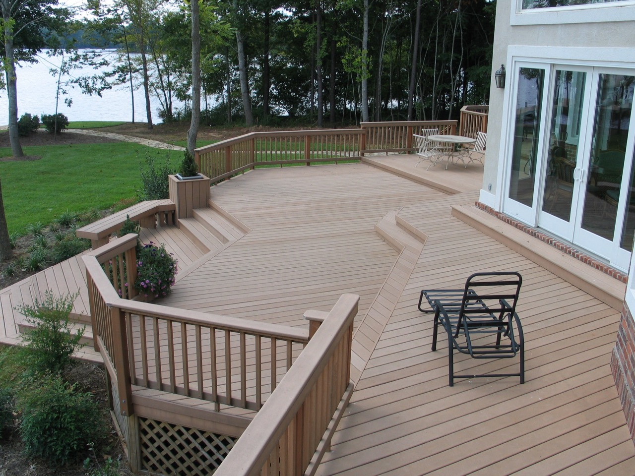multilevel deck with oversized steps for style and seating by archadeck - Deck Stairs Design Ideas