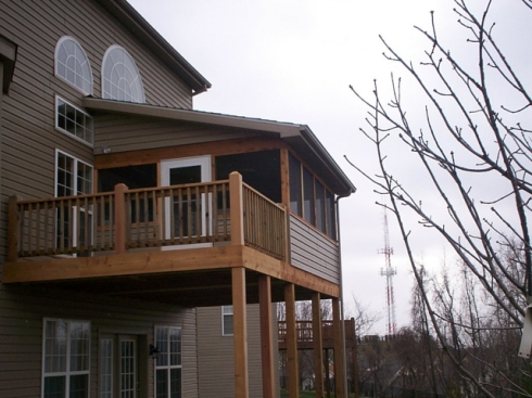 Screened Porch Designed To Match The Home's Exterior by St. Louis Deck Builders, Archadeck