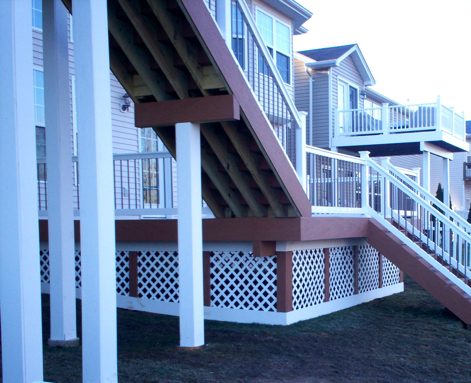 Deck stairs ideas how to choose the best stair design for for Two story spiral staircase