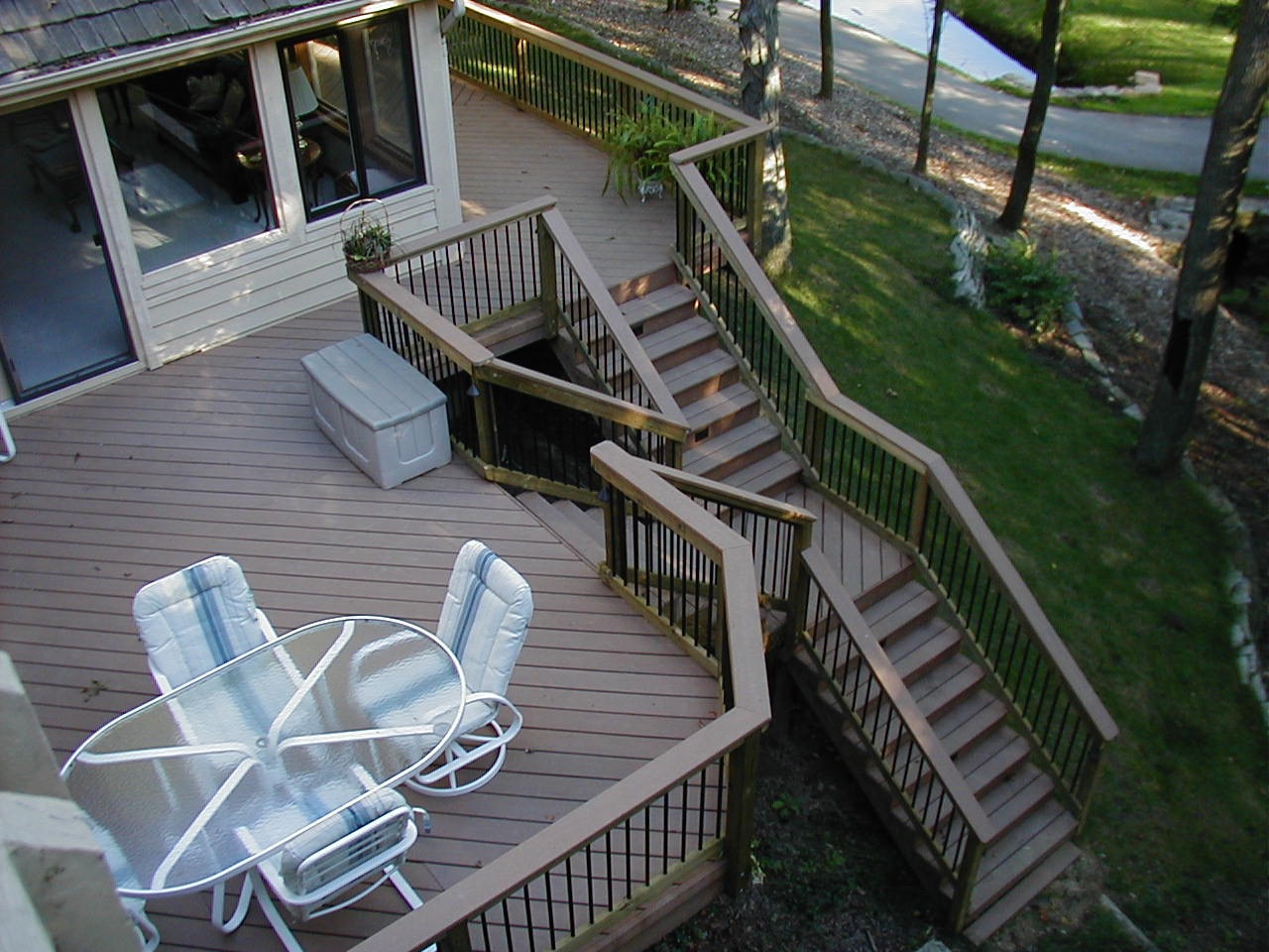 Deck stairs ideas how to choose the best stair design for your deck st louis decks screened for Home designer stairs with landing