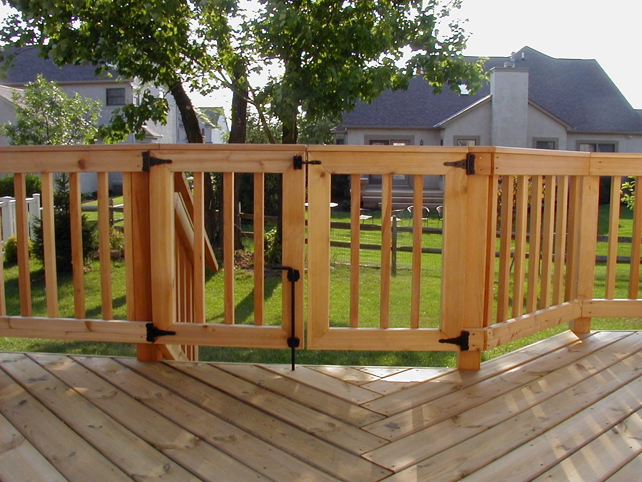 Deck railing ideas how to choose the best rail design for your deck rail with safety gate by archadeck baanklon Gallery