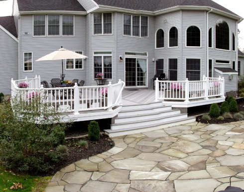 Elegant White Vinyl Rails with Gray Decking, by Archadeck