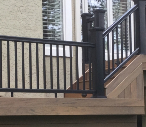 Modern Low Maintenance Decking with Black Rails and Sleek Balusters by Archadeck