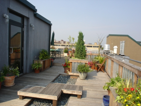 Rooftop Deck with Wood Rails, Metal Inserts and Metal Handrail for Style and Safety, by Archadeck