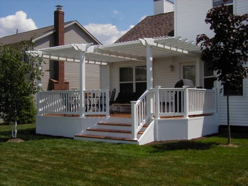 Traditional Deck with White Vinyl Rails, Balusters, Skirting and Pergola by Archadeck