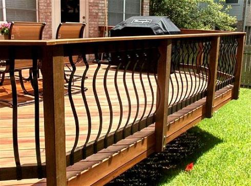 Traditional Wood Deck Rails with Curved Iron Balusters by Archadeck