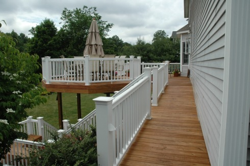 Wood Deck With Contrasting White Rails and Balusters by Archadeck