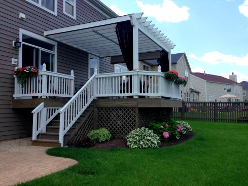 Deck Pergola Designed with Mosquito Curtains by Archadeck