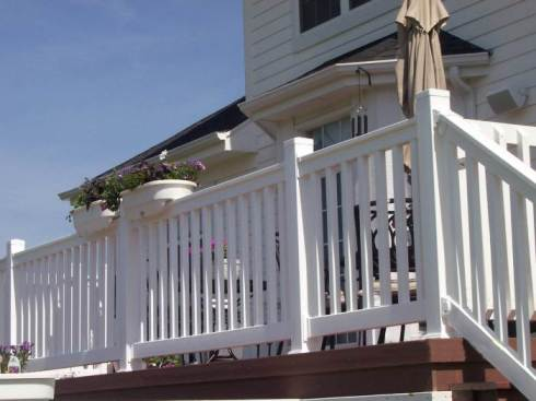 Deck with White Railing by Archadeck