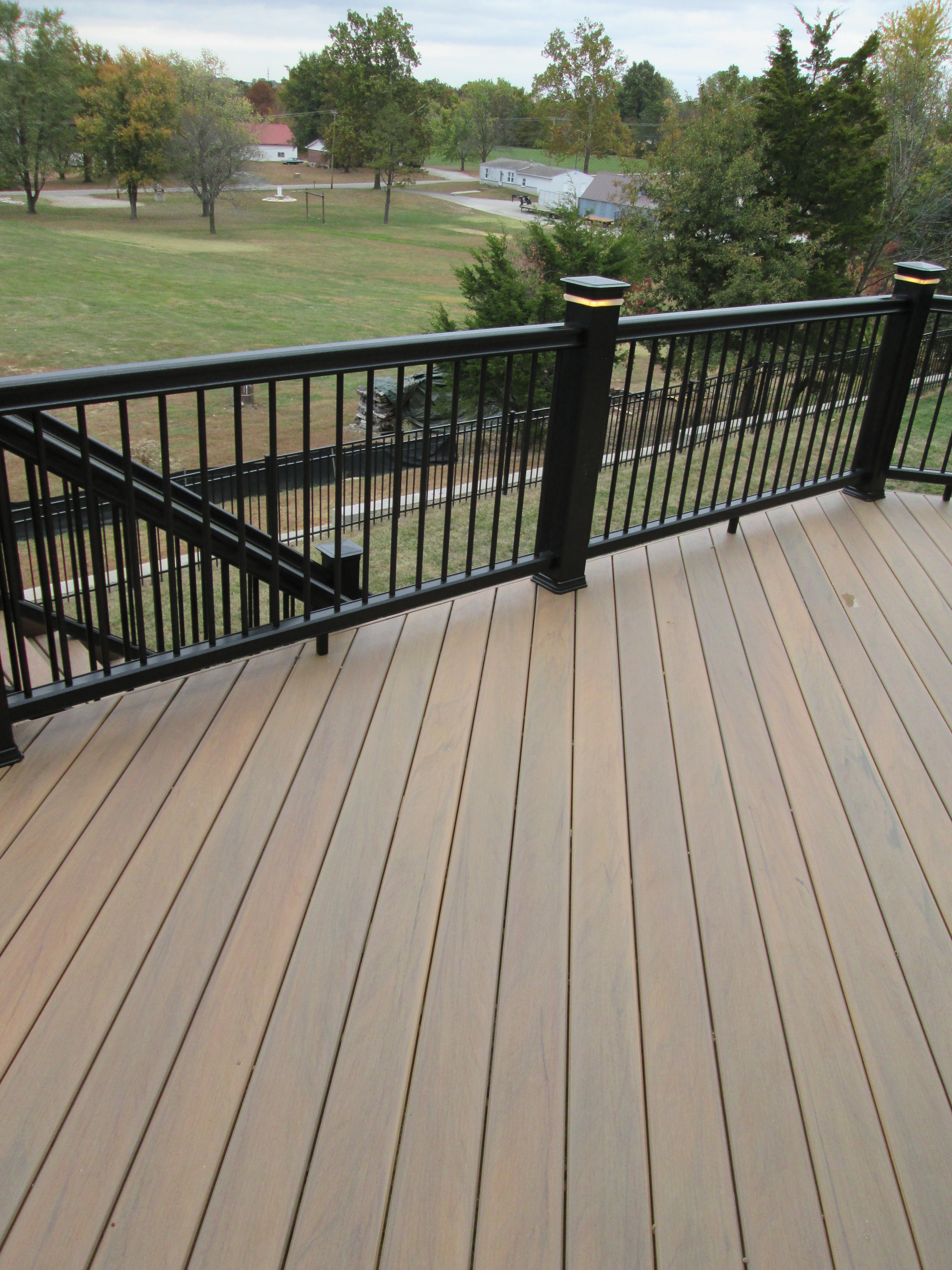deck design ideas real wood vs decks that look like wood
