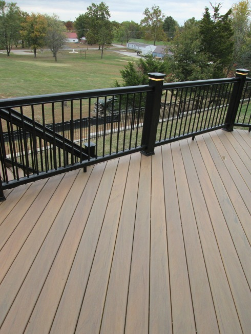 Deck design ideas real wood vs decks that look like wood for Capped composite decking prices